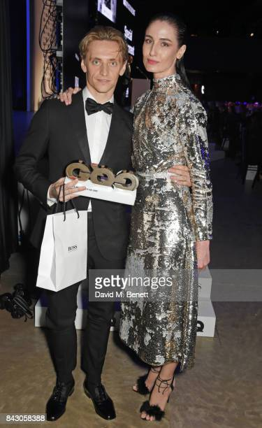 Sergei Polunin winner of the Creative Maverick of the Year award and Erin O'Connor attend the GQ Men Of The Year Awards at the Tate Modern on...