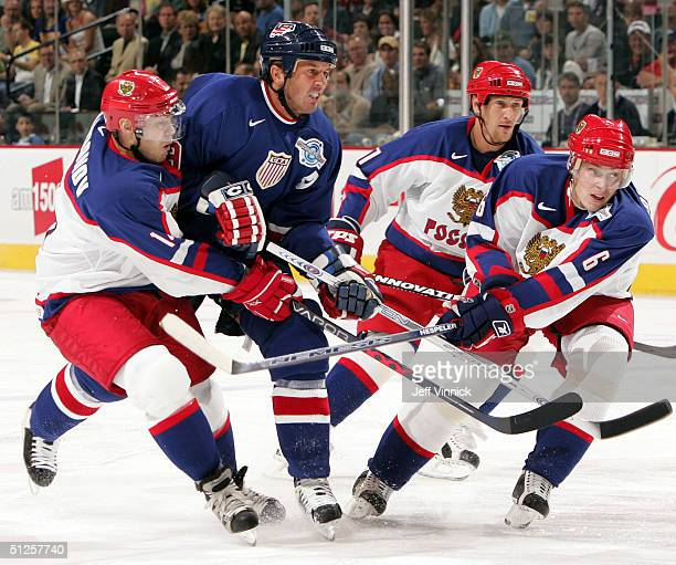 Sergei Samsonov, Alex Kovalev and Anton Volchenkov of Team Russia keep Mike Modano of Team USA in check during the third period of their game in the...