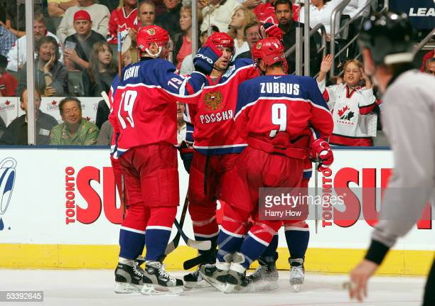 Sergei Samsonov of Team Russia celebrates a goal with Dainius Zubrus and Alexei Yashin against Team Slovakia for a 31 lead during the second period...