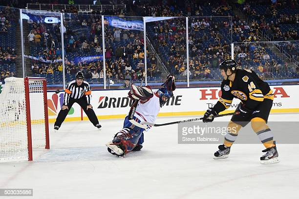 Sergei Samsonov of the Boston Bruins scores in a shoot out against Richard Sevigny of the Montreal Canadiens in the alumni game December 31 2015...