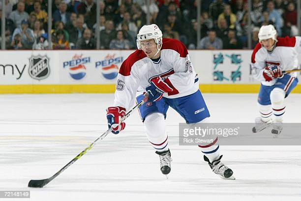 Sergei Samsonov of the Montreal Canadiens skates the puck through neutral ice against the Buffalo Sabres during their NHL preseason game on October...