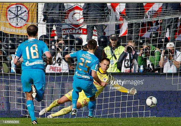 Sergei Semak of FC Zenit St Petersburg scores a penalty shot against Artem Rebrov of FC Spartak Moscow during the Russian Football League...