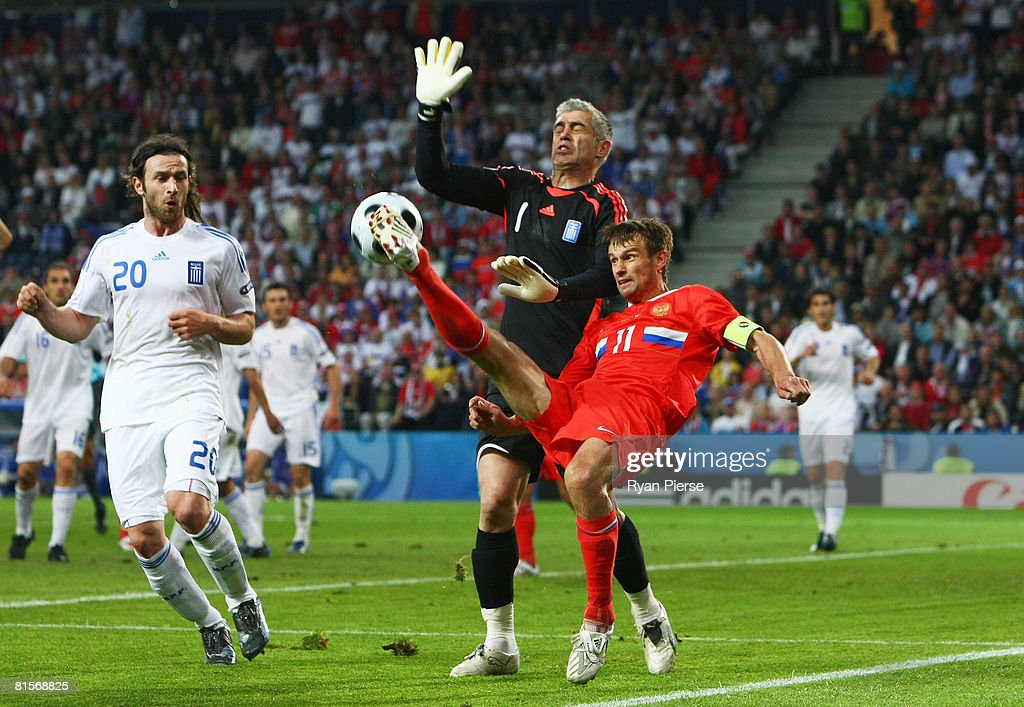 Sergei Semak of Russia passes the ball past goalkeeper Antonios Nikopolidis (#1) of Greece during the UEFA EURO 2008 Group D match between Greece and Russia at Stadion Wals-Siezenheim on June 14, 2008 in Salzburg, Austria.