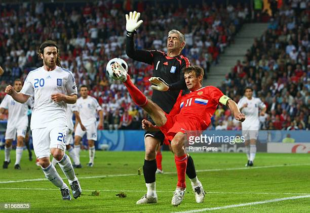 Sergei Semak of Russia passes the ball past goalkeeper Antonios Nikopolidis of Greece during the UEFA EURO 2008 Group D match between Greece and...