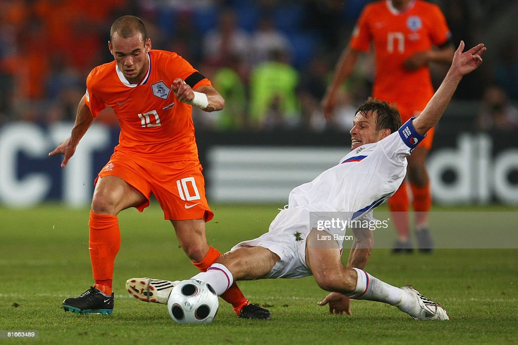 Sergei Semak of Russia tackles Wesley Sneijder of Netherlands during the UEFA EURO 2008 Quarter Final match between Netherlands and Russia at St. Jakob-Park on June 21, 2008 in Basel, Switzerland.
