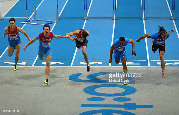 Sergei Shubenkov of Russia crosses the line first to win gold aheado of Paolo Dal Molin of Italy in the Men's 60m Hurdles Final during day one of the...