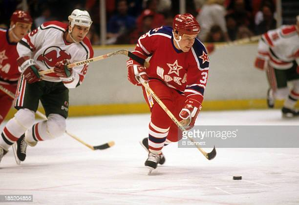 Sergei Starikov of CSKA Moscow skates with the puck during the 1988-89 Super Series against the New Jersey Devils on January 2, 1988 at the Brendan...