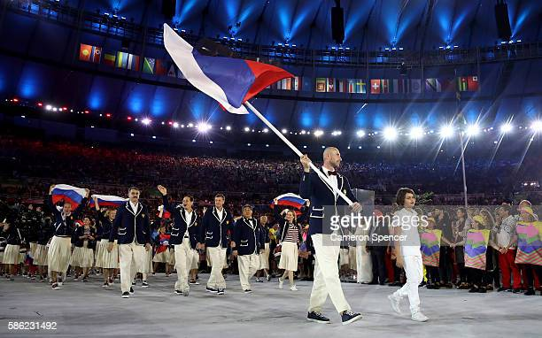 Sergei Tetiukhin of Russia carries the flag during the Opening Ceremony of the Rio 2016 Olympic Games at Maracana Stadium on August 5 2016 in Rio de...