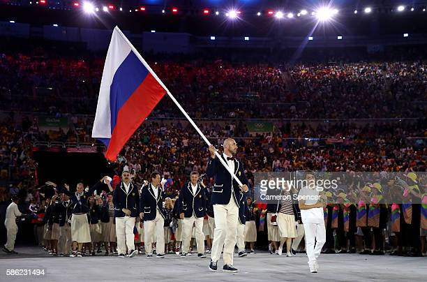 Sergei Tetiukhin of Russia carries the flag during the Opening Ceremony of the Rio 2016 Olympic Games at Maracana Stadium on August 5, 2016 in Rio de...
