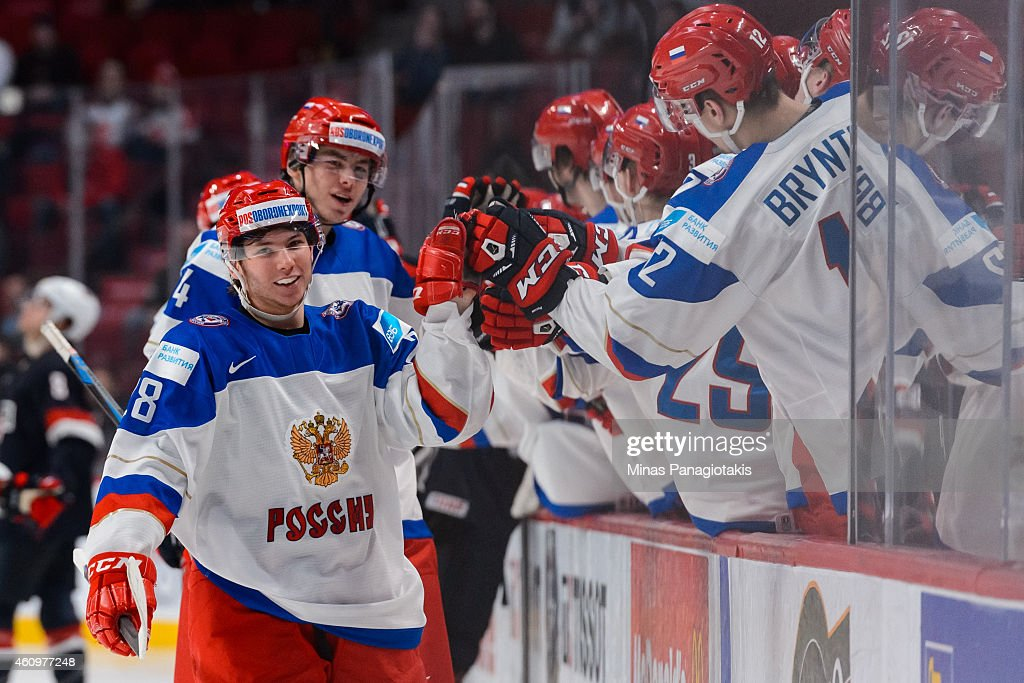 Sergei Tolchinsky #28 of Team Russia celebrates his goal with teammates on the bench in a quarterfinal round during the 2015 IIHF World Junior Hockey Championships against Team United States at the Bell Centre on January 2, 2015 in Montreal, Quebec, Canada. Team Russia defeated Team United States 3-2.