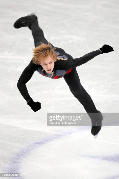 Sergei Voronov of Russia competes in the Men's Singles Short Program during day one of the ISU Junior Senior Grand Prix of Figure Skating Final at...