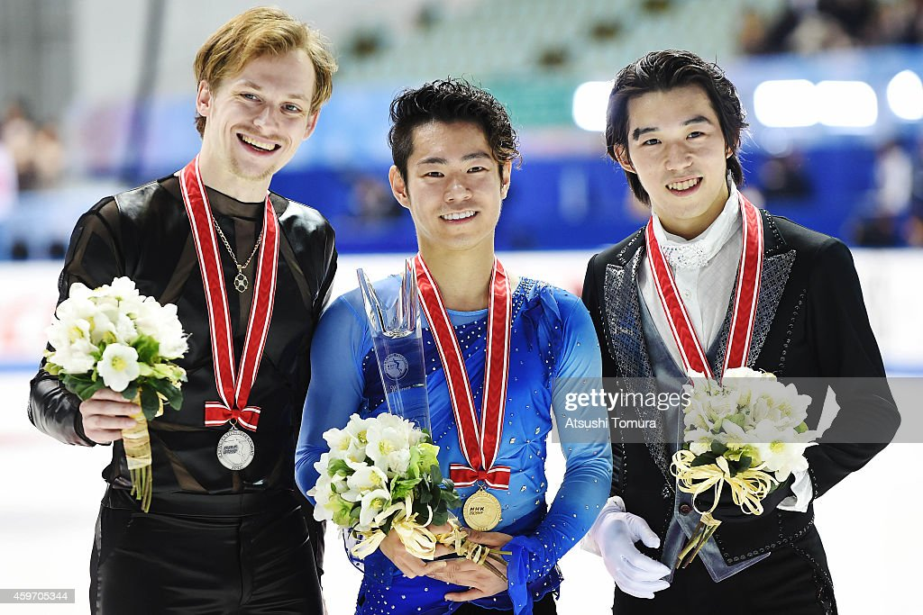 Sergei Voronov of Russia (Silver), Daisuke Murakami of Japan (Gold) and Takahito Mura of Japan (Bronze) pose with their medals in the victory ceremony during day two of ISU Grand Prix of Figure Skating 2014/2015 NHK Trophy at the Namihaya Dome on November 29, 2014 in Osaka, Japan.