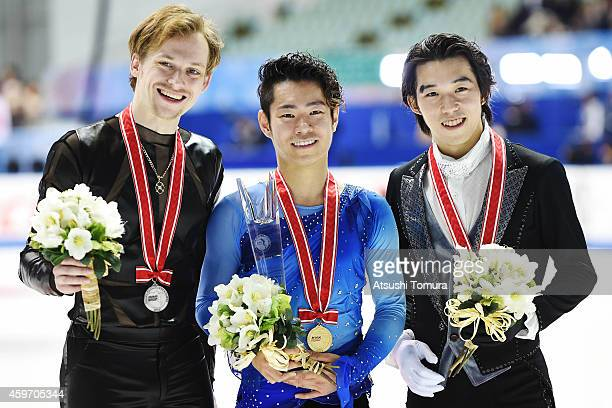 Sergei Voronov of Russia Daisuke Murakami of Japan and Takahito Mura of Japan pose with their medals in the victory ceremony during day two of ISU...