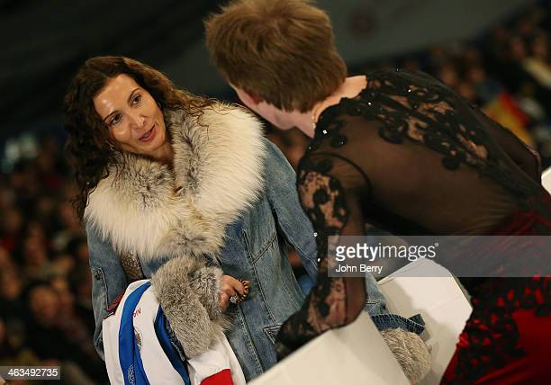 Sergei Voronov of Russia gets a last advice from his coach Eteri Tutberidze before competing in the Men Free Skating event of the ISU European Figure...