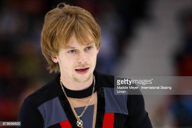 Sergei Voronov of Russia looks on following his Mens Short program on Day 1 of the ISU Grand Prix of Figure Skating at Herb Brooks Arena on November...