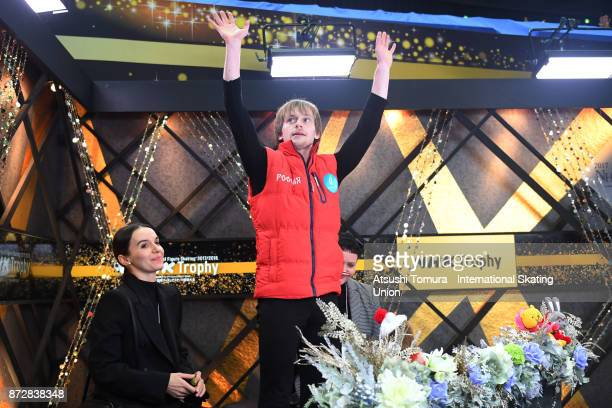 Sergei Voronov of Russia reacts after competing at the kiss and cry with his coach during the ISU Grand Prix of Figure Skating at on November 11 2017...