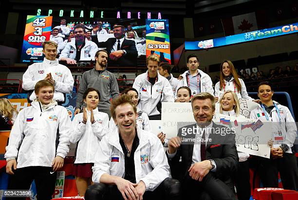 Sergei Voronov of Team Europe reacts with team captain Christopher Dean and teammates after seeing his score in the Men's Singles Short Program on...