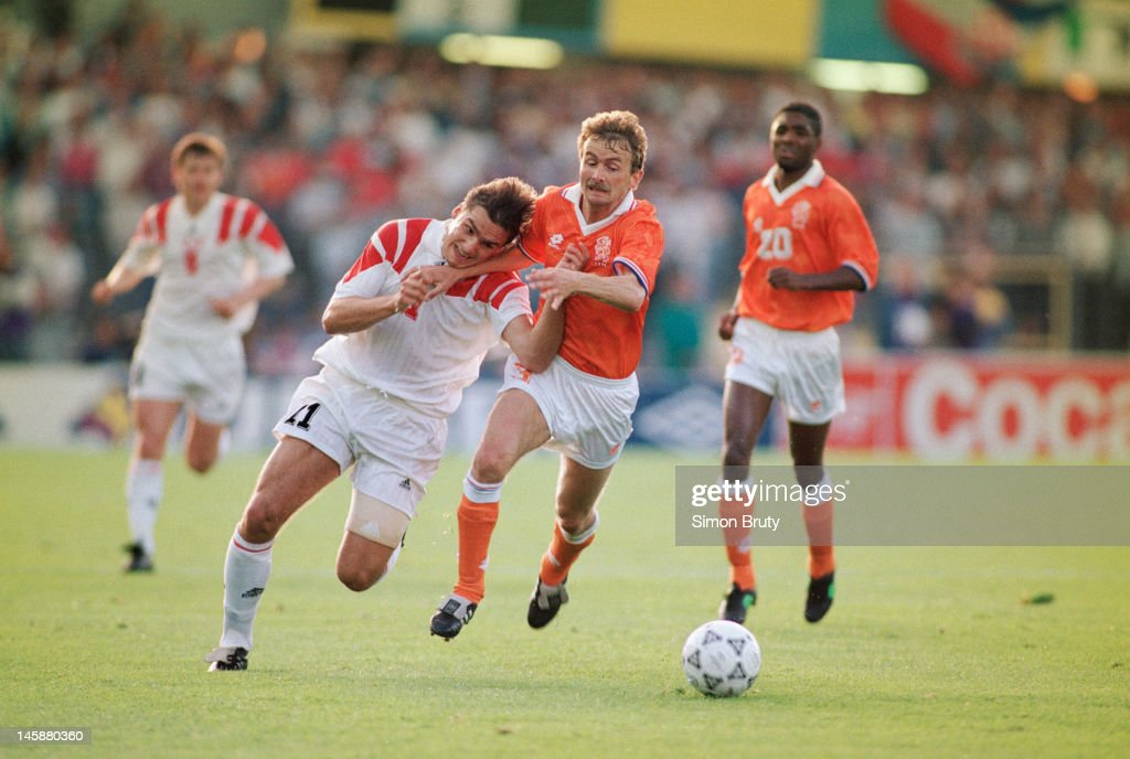 Sergei Yuran of USSR is tackled by Adri van Tiggelen of Netherlands during the UEFA European Championships 1992 Group 2 match between Netherlands and USSR held at the Ullevi Stadium on June 15, 1992 in Gothenburg, Sweden.