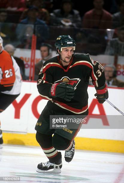 Sergei Zholtok of the Minnesota Wild skates on the ice during an NHL game against the Philadelphia Flyers on December 8 2001 at the First Union...