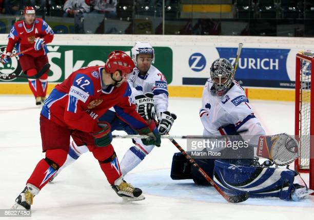 Sergei Zinoviev of Russia tries to score over Eddy Ferhi goalkeeper of France during the IIHF World Ice Hockey Championship preliminary round group B...