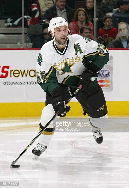 Sergei Zubov of the Dallas Stars looks to make a pass play against the Ottawa Senators during their NHL game on December15 2005 at the Corel Centre...