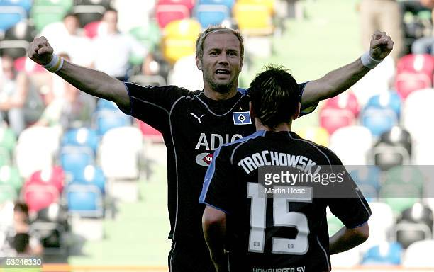 Sergej Barbarez and Piotr Trochowski of HSV celebrate scoring the first goal during the Intertoto Cup, third round match between DU Leiria and...