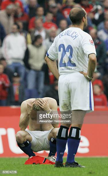 Sergej Barbarez and Stefan Beinlich of Hamburg are dejected after the 1. Bundesliga match between Hanover 96 and Hamburger SV at the AWD Arena on May...