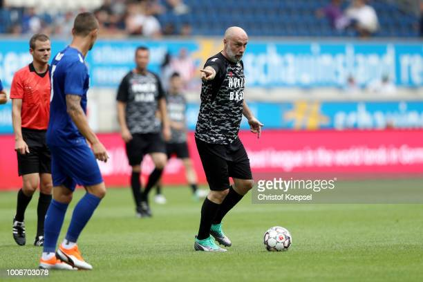 Sergej Barbarez of Bajas Friends runs with the ball during the farewell match of Branimir Bajic during the Duisburg Cup der Traditionen at...
