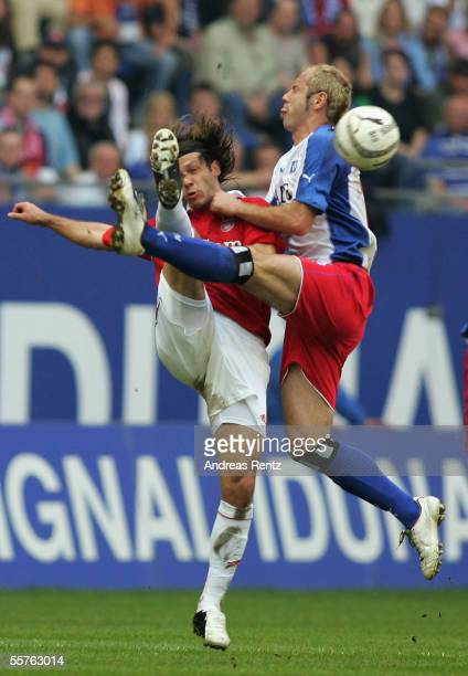 Sergej Barbarez of Hamburg challenges for the ball with Martin Demichelis of Munich during the Bundesliga match between Hamburger SV and Bayern...