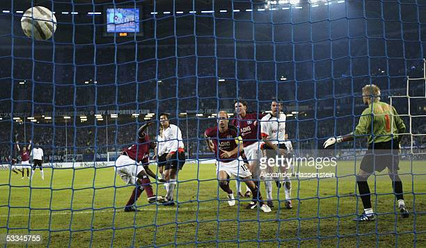 Sergej Barbarez of Hamburg scores the first goal during the Intertoto Cup Final between Hamburger SV and FC Valencia at the AOL Arena on August 9,...