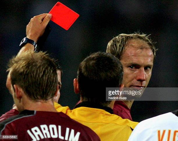 Sergej Barbarez of HSV gets a Red Card from referee Stuart Dougal during the Intertoto Cup Final between Hamburger SV and FC Valencia at the AOL...