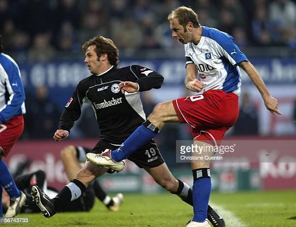 Sergej Barbarez of HSV shoots for the second goal beside Bernd Korzynietz of Bielefeld during the Bundesliga match between Hamburger SV and Arminia...