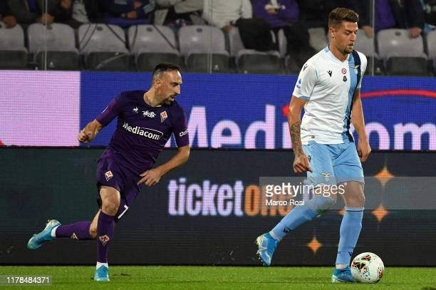 Sergej Milinkov Savic of SS Lazio compete for the ball with Franck Ribery of Fiorentina ACF during the Serie A match between ACF Fiorentina and SS...