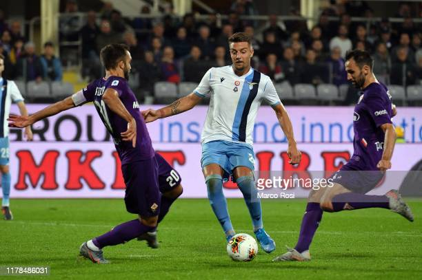 Sergej Milinkov Savic of SS Lazio compete for the ball with German Pezzella of Fiorentina ACF during the Serie A match between ACF Fiorentina and SS...