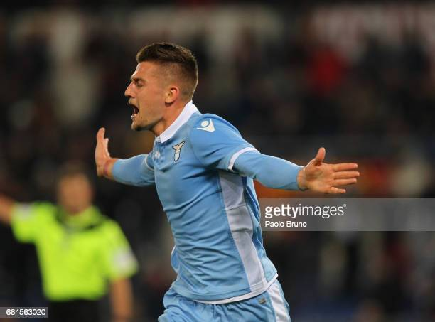 Sergej Milinkovic of SS Lazio celebrates after scoring the opening goal during the TIM Cup match between AS Roma and SS Lazio at Stadio Olimpico on...