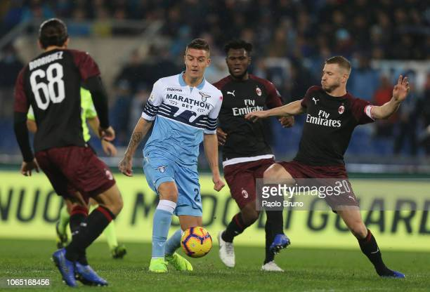Sergej Milinkovic of SS Lazio competes for the ball with AC Milan players during the Serie A match between SS Lazio and AC Milan at Stadio Olimpico...