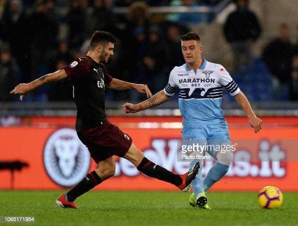 Sergej Milinkovic of SS Lazio competes for the ball with Patick Cutrone of AC Milan during the Serie A match between SS Lazio and AC Milan at Stadio...