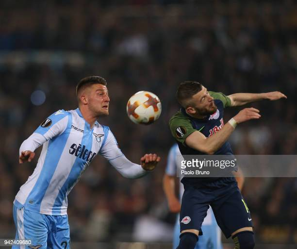 Sergej Milinkovic of SS Lazio competes for the ball with Valon Berisha of RB Salzburg during the UEFA Europa League quarter final leg one match...