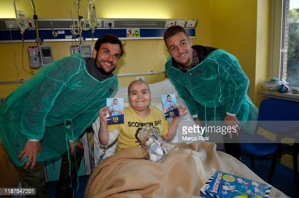 Sergej Milinkovic Savic and Marco Parolo of SS Lazio pose during the SS Lazio players visit 'Clinica Mandelli' Hospital on December 10 2019 in Rome...