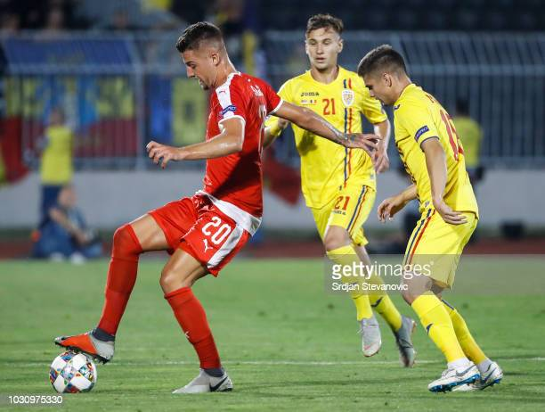 Sergej Milinkovic Savic of Serbia in action against Paul Anton of Romania during the UEFA Nations League C group four match between Serbia and...