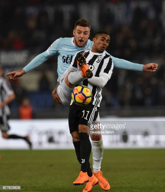Sergej Milinkovic Savic of SS Lazio and Douglas Costa de Souza of Juventus FC in action during the serie A match between SS Lazio and Juventus at...