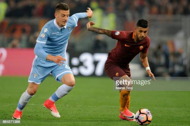 Sergej Milinkovic Savic of SS Lazio battles with Emerson palmieri of AS Roma during the TIM Cup match between AS Roma and SS Lazio at Stadio Olimpico...