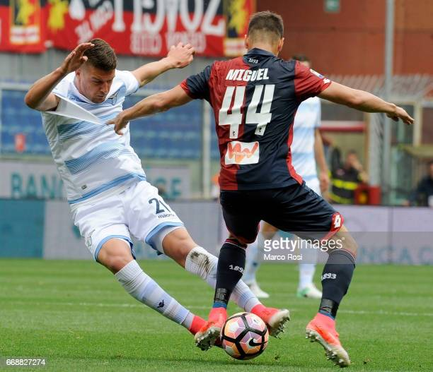 Sergej Milinkovic Savic of SS Lazio battles with Miguel Veloso of Genoa CFC during the Serie A match between Genoa CFC and SS Lazio at Stadio Luigi...