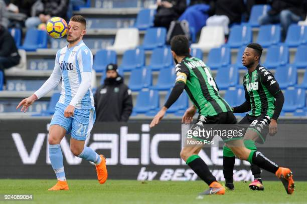 Sergej Milinkovic Savic of SS Lazio compete for the ball Francesco Magnanelli of US Sassuolo during the serie A match between US Sassuolo and SS...