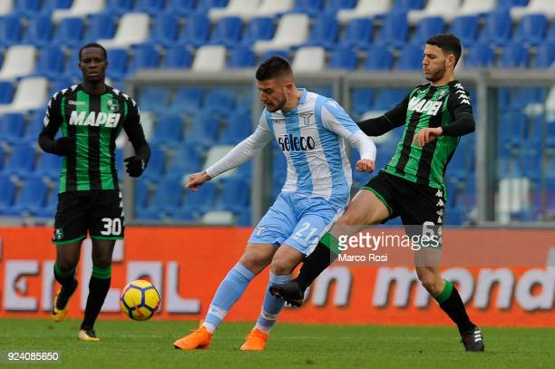 Sergej Milinkovic Savic of SS Lazio compete for the ball Luca Mazzitelli of US Sassuolo during the serie A match between US Sassuolo and SS Lazio at...
