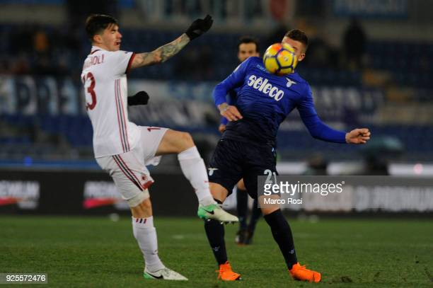 Sergej Milinkovic Savic of SS Lazio compete for the ball with Alessio Romagnoli of AC Milan during the TIM Cup match between SS Lazio and AC Milan at...