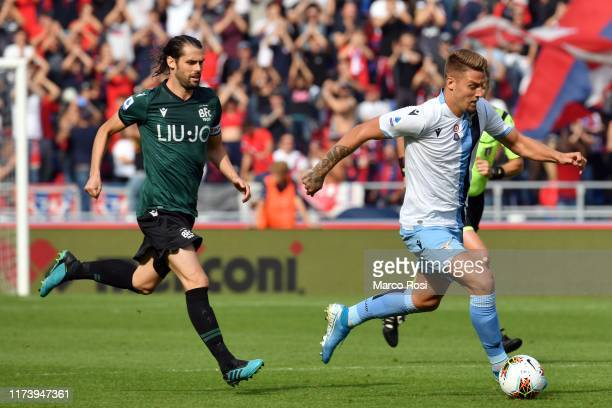 Sergej Milinkovic Savic of SS Lazio compete for the ball with Andrea Poli of Bologna FC during the Serie A match between Bologna FC and SS Lazio at...