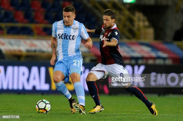 Sergej Milinkovic Savic of SS Lazio compete for the ball with compete for the ball with Simone Verdi of Bologna FC during the Serie A match between...