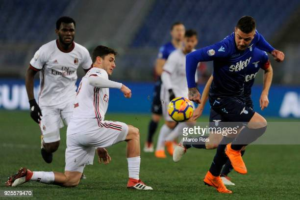 Sergej Milinkovic Savic of SS Lazio compete for the ball with Davide Calabria of AC Milan during the TIM Cup match between SS Lazio and AC Milan at...