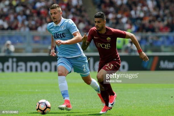 Sergej Milinkovic Savic of SS Lazio compete for the ball with Emerson Palmieri of AS Roma during the Serie A match between AS Roma and SS Lazio at...